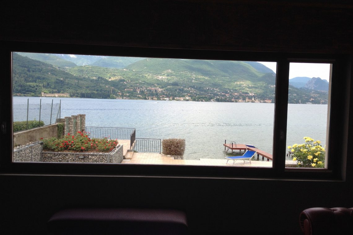 Waterfront villa Lake Garda rent, pool, beach, private dock 12
