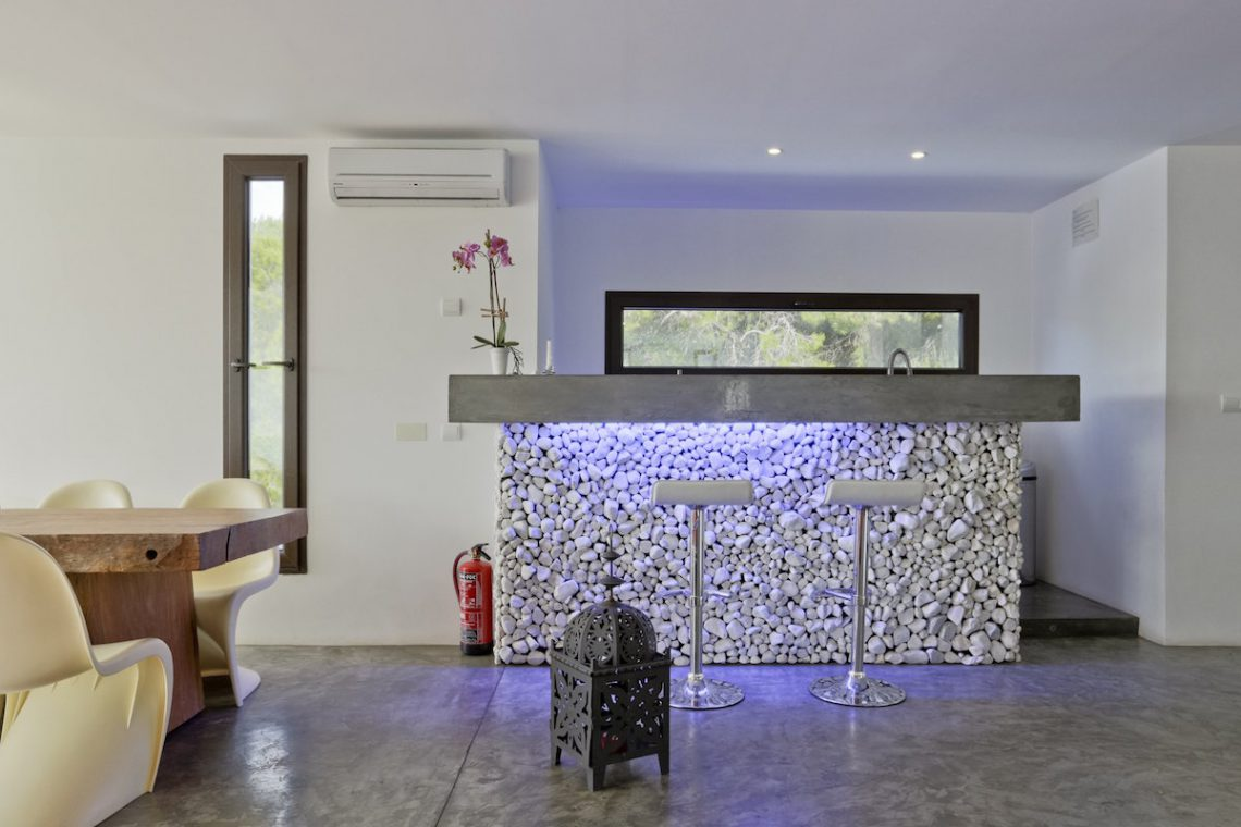 Minimalist villa Ibiza for rent with tropical pool 11
