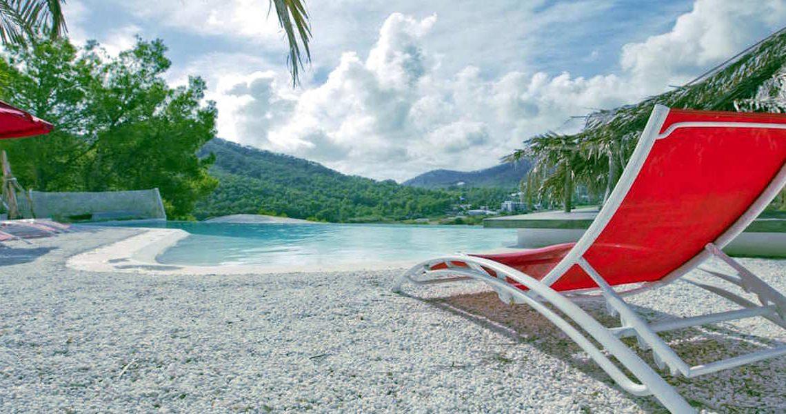 Minimalist villa Ibiza for rent with tropical pool slider
