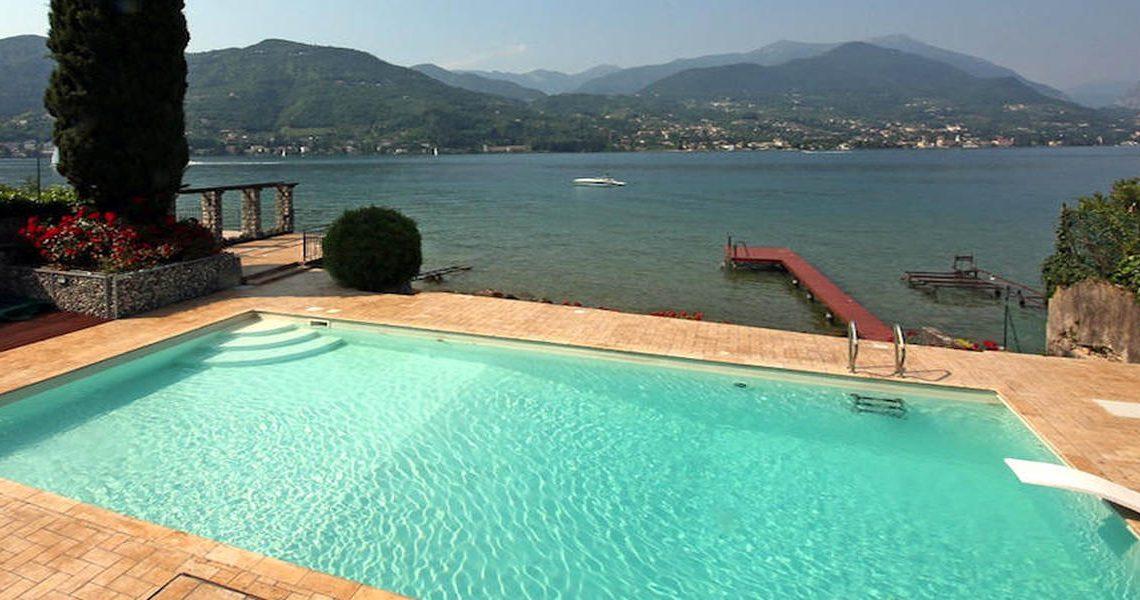Waterfront villa Lake Garda rent, pool, beach, private dock slider