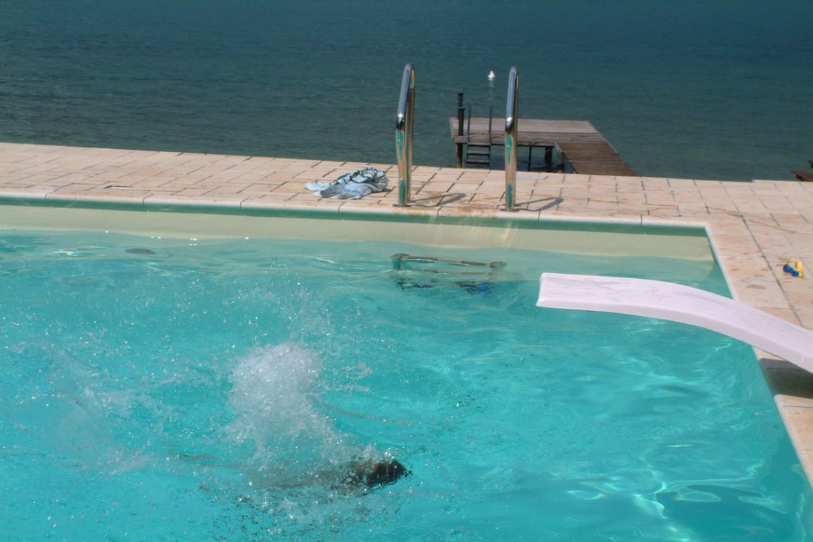 Waterfront villa Lake Garda rent, pool, beach, private dock 07